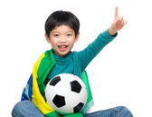 Little boy holding soccer ball with Brazil flag — 图库照片
