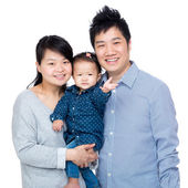 Happy asia family with father, mother and their baby daughter — Stockfoto