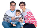 Asian couple with baby son — Stock Photo