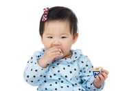 Little girl with teething — Stock Photo
