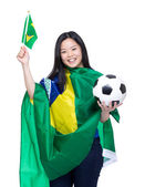 Asian soccer fans draped with Brazil flag — Stock Photo