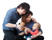Young happy family with baby girl — Stockfoto