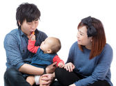 Asian baby girl giving candy to her dad — Stock Photo