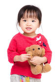Asia little girl with her doll — Stock Photo
