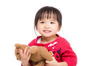 Beautiful little girl hug with bear — Stockfoto