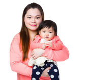 Mother holding little girl — Stock Photo