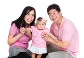 Happy family with baby daughter — Stockfoto