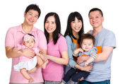Two happy family with baby — Stock Photo