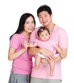 Happy family with daughter — Stock Photo