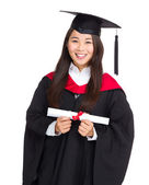 Beautiful young graduation woman — Stock Photo