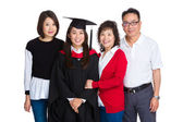 Happy family gathered together with graduate student — Stock Photo