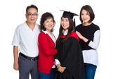 Family portrait with graduation girl — Stock Photo