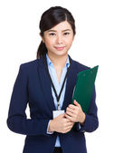Smiling businesswoman holding clipboard — Stock Photo