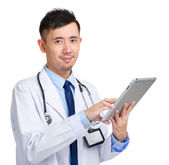 Doctor working on digital tablet — Stock Photo