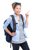 Asian backpacker with finger pointing up — Stock Photo