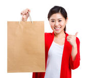 Shopping young woman show thumb up with bag — 图库照片