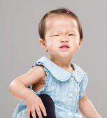 Baby girl making funny face — Stockfoto