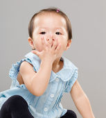 Little girl with hand cover her mouth — Stock Photo