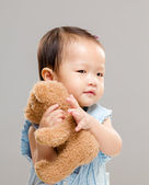 Little girl with her doll — Stock Photo