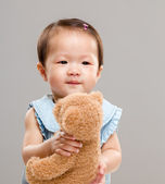 Girl hug doll bear — Stock Photo