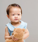 Little girl play with doll — Stock Photo