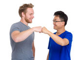 Two arm fist punch each other for caucasian and asian man  — Stockfoto
