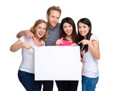 Group of people with diverse ethnicities holding blank sign — Stock Photo