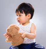 Little boy holding doll bear — Stockfoto
