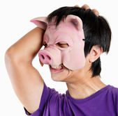 Man wearing pig mask with headache — Photo