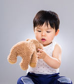 Little boy playing with doll bear — Stock Photo