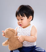 Cute baby boy play with doll — Stock Photo