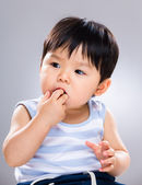 Baby sucking finger into mouth — Stock Photo