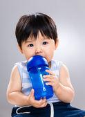 Little boy drinking from water bottle — Stock Photo