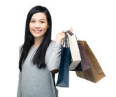Happy shopping woman smiling — Stock Photo