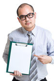 Businessman show clipboard with finger — Stock Photo
