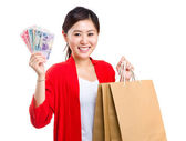 Girl with shopping bag and cash money — Stock Photo