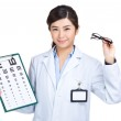 Asian doctor hold eye chart and glasses — Stock Photo #47769247