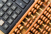Modern calculator and abacus  — Stock Photo