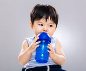 Little boy drink with water bottle — Stock Photo