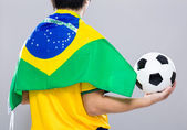 Backview of sportman wear with Brazil flag and hold football — Stock Photo