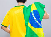 Brazilian football supporter hold with Brazil flag — Stock Photo
