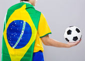 Backview of football player wear with Brazil flag and hold footb — Stock Photo