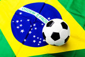 Waved Brazilian flag and football — Stock Photo