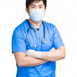 Doctor with face mask in surgical uniform — Stock Photo