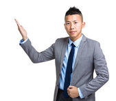 Asian businessman with open hand palm — Stockfoto