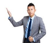 Asian businessman with open hand palm — Foto de Stock