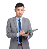 Asian business man write on clipboard — Stock Photo
