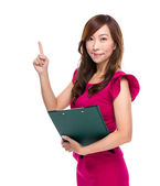 Secretary with clipboard and finger up — Stock Photo