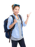 Woman with backpack and finger point up — Stock Photo