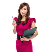 Business woman with clipboard and pen point out — Stock Photo